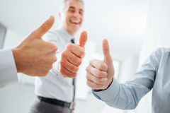 Cheerful business people thumbs up Stock Photos