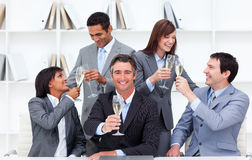 Cheerful business people toasting with Champagne Stock Photo