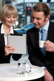 Cheerful business people using digital tablet royalty free stock images