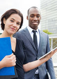 Cheerful business people working outdoors Royalty Free Stock Photo