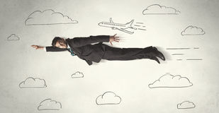 Cheerful business person flying between hand drawn sky clouds Stock Photography