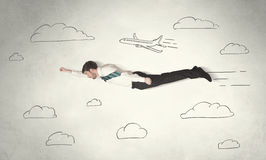 Cheerful business person flying between hand drawn sky clouds Royalty Free Stock Photos