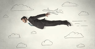 Cheerful business person flying between hand drawn sky clouds Stock Images