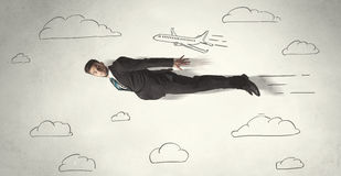 Cheerful business person flying between hand drawn sky clouds Stock Photos