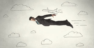 Cheerful business person flying between hand drawn sky clouds Stock Photo