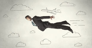 Cheerful business person flying between hand drawn sky clouds Stock Image