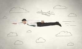 Cheerful business person flying between hand drawn sky clouds. Concept on background Stock Photography