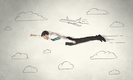 Cheerful business person flying between hand drawn sky clouds. Concept on background Royalty Free Stock Images