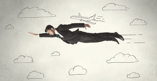 Cheerful business person flying between hand drawn sky clouds. Concept on background Stock Image