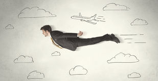 Cheerful business person flying between hand drawn sky clouds Royalty Free Stock Photo