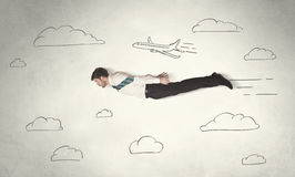 Cheerful business person flying between hand drawn sky clouds Royalty Free Stock Photography