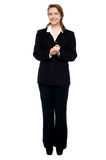 Cheerful business professional with hands clasped Stock Photo