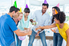 Cheerful business team celebrating with champagne Royalty Free Stock Photography