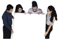 Cheerful business team looking at a billboard Royalty Free Stock Photos