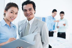 Cheerful business team. Portrait of a cheerful business team smiling and looking at camera Royalty Free Stock Photos