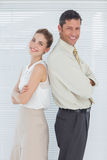Cheerful business team posing back to back Royalty Free Stock Images