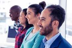 Cheerful business team standing in row Stock Photo
