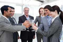 Cheerful business team toasting with Champagne. To celebrate a success Royalty Free Stock Image