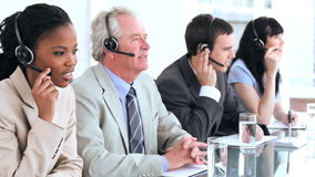 Cheerful business team using headsets Royalty Free Stock Photos