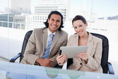 Cheerful business team using a tablet computer Stock Image