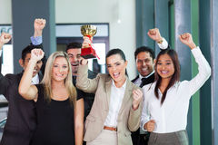 Cheerful business team. Winning an award for their performance stock photography