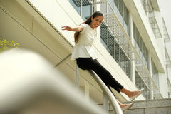 Cheerful Business Woman Going Downstairs Sliding On Rail For Joy Royalty Free Stock Image