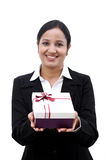 Cheerful business woman holding a gift box. Against white Royalty Free Stock Photography