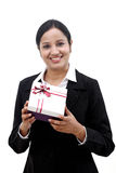 Cheerful business woman holding a gift box Royalty Free Stock Images