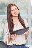 Cheerful business woman holding laptop Stock Images