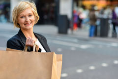 Cheerful business woman holding shopping bag Royalty Free Stock Photo