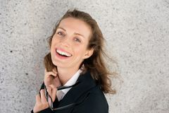 Cheerful business woman laughing with glasses Stock Photo