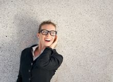 Cheerful business woman laughing with glasses Royalty Free Stock Photos