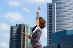 Cheerful business woman punching the air Stock Image