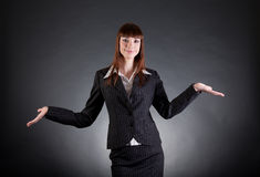 Cheerful business woman showing open hands Stock Image