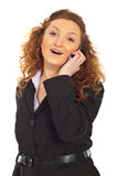 Cheerful business woman speaking by cell phone Royalty Free Stock Photos