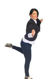 Cheerful business woman standing in one leg Royalty Free Stock Images
