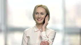 Cheerful business woman talking on cell phone. stock video