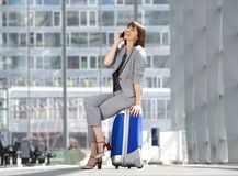 Cheerful business woman talking on mobile phone Stock Images