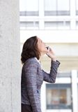 Cheerful business woman using mobile phone Stock Images