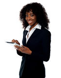 Cheerful business woman using tablet pc Stock Photos