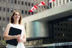 Cheerful business woman walking downtown in a Canadian city Royalty Free Stock Photography