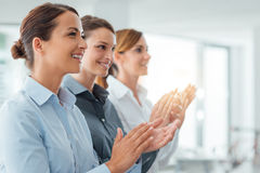 Cheerful business women applauding Stock Image