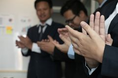 Cheerful businessman applauding at conference. successful busine. Ss team clapping hands for great work at meeting Royalty Free Stock Photo