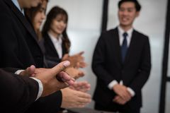 Cheerful businessman applauding at conference. successful busine. Ss team clapping hands for great work at meeting Royalty Free Stock Photos