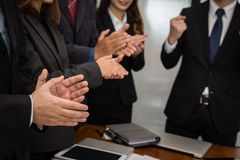 Cheerful businessman applauding at conference. successful busine. Ss team clapping hands for great work at meeting Stock Image