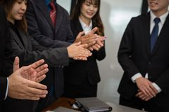 Cheerful businessman applauding at conference. successful business. Team clapping hands for great work at meeting Royalty Free Stock Image