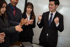 Cheerful businessman applauding at conference. successful busine. Ss team clapping hands for great work at meeting Royalty Free Stock Image