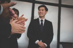 Cheerful businessman applauding at conference. successful busine. Ss team clapping hands for great work at meeting Stock Photo