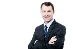 Cheerful businessman with arms folded Stock Image