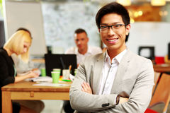Cheerful businessman with arms folded Stock Photos
